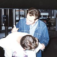 Morrissey signing a pillow